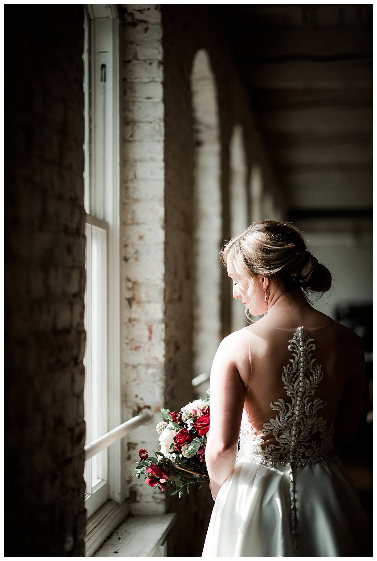 Bridal portrait near a window inside the Thomas Kay Woolen Mill at the Willamette Heritage Center